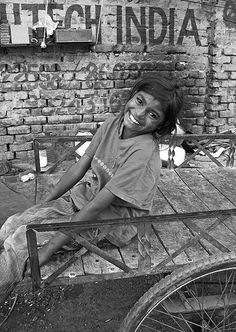 "Slum-side Smile by Meanest Indian: ""And somewhere there are engineers helping others fly faster than sound.  But, where are the engineers helping those who must live on the ground?"" - words from an OXFAM poster. #Photography #India"