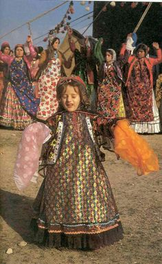 Iranian traditional clothes and dance.