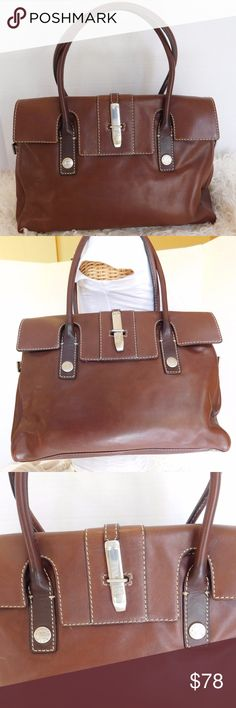 """VINTAGE MICHAEL KORS SOFT LEATHER SATCHEL HANDBAG BRAND- MICHAEL KORS  COLOR- BROWN  MATERIAL- LEATHER  STYLE- SATCHEL  SIZE- 15"""" length, 11"""" height, 4"""" width, 10"""" strap drop  FEATURES-OUTSIDE- BACK SLIP POCKET, LOGO DETAILS  INSIDE-3 MAIN COMPARTMENT, 3 SLIP POCKETS,1 ZIPPER POCKET  CONDITION-PRE-OWNED VERY GOOD, MINOR SCUFFS AT EDGES AND LITE STRATCHES.   Bin- PB 13 Michael Kors Bags Satchels"""