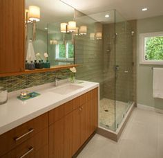 EVEN THOUGH IT'S off the master bedroom, is it fair to refer to a 92-square-foot bathroom with one vanity and fuddy-duddy fluorescent lighting as a master bath?  Maybe not; but now that Anita Dawson has updated this still-tiny space, the room deserves all that the title implies. See the full story here!  #remodel #smallspaces #bathroom