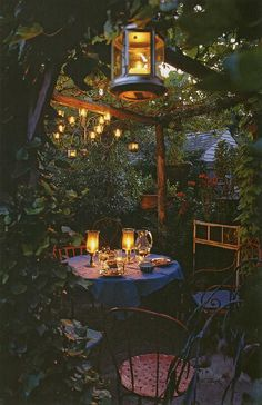 A leafy gazebo lit with candles, perfect.