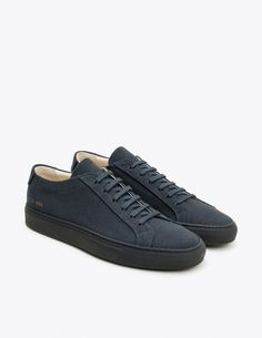 """Sneakers from <a href=""""http://tres-bien.com/common-projects/"""" class=""""uniquelink"""">Common Projects</a>. Canvas upper with tonal stitching. Style number and size in gold print on the outer sides. Textile lining. Leather insole. Rubber outsole. Dust bag and extra pair of laces included."""