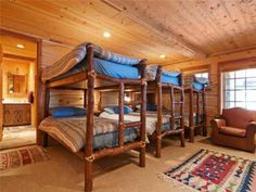I love bunk rooms. This is the Romney's log cabin.