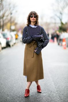 A wrap skirt paired with a striped top and mules.