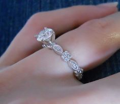 I adore this one!!!! The only thing I would change is the center stone-I want an oval