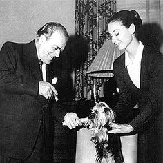 Heitor Villa-Lobos playing with a dog with Audrey Hepburn...