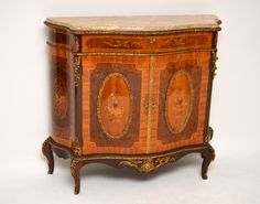 This top quality antique French style marble top cabinet has loads of fine features