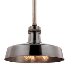 Hudson Valley Lighting's Hudson Falls has a metal shade that protects the bulbs, which and illuminate a broad work space. This pendant takes industrial era inspiration and adds a touch of luxury to it.