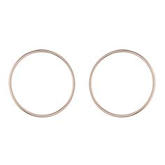 The Lines collection is built around the idea of an elegant simplicity, and the Large Circle earrings have a pure line and are very versatile : shiny and light, they can be worn day and night. They are made of rose gold plated sterling silver.
