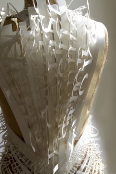 The word paper dress by Sopi On a Chinese artist