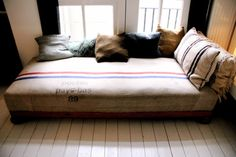 daybed.  My husband can't stand daybeds.  I love them.  I'm showing him this photo.  That will switch him over!