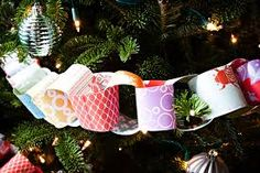 We made paper chains out of scrapbook paper for our tree this year. I love the look plus if I use up all this paper I can stop kidding myself about getting into scrapbooking, lol. Christmas Paper Chains, Diy Christmas Garland, Christmas Fun, Look Plus, Diy Weihnachten, Xmas Tree, Christmas Tree Decorations, Holiday Crafts, Gift Wrapping