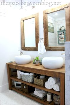 Single vanity with different more rectangular sinks and one large mirror.