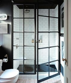 Manhattan apartment bathroom with black walls, white subway tiles and industrial style steel framed shower Bad Inspiration, Bathroom Inspiration, Interior Inspiration, Home Interior, Interior Design, Interior Doors, Monochrome Interior, Manhattan Apartment, York Apartment