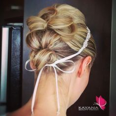A modern artistic flair to the traditional bowtie updo - hairstyling by Kayana Beauty Trends www.kayanabeautytrends.com