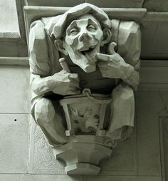 Gargoyle ....cook, stirring a pot and taking a taste: Morningside Heights. The Britannia at 527 West 110th Street. New York