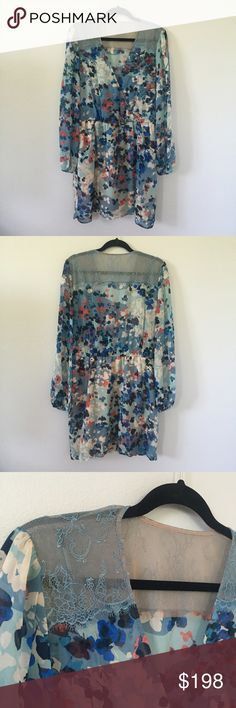 NWOT BCBGMaxAzria Dress Brand new dress!! Doesn't have a tag on the dress but I have the plastic bag it was shipped in with the sticker tag on it. Can be given as a gift, this is such a beautiful dress! Light and flowy with really pretty colors and lace detailing. BCBGMaxAzria Dresses Long Sleeve