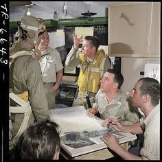 Debriefing aboard the USS Yorktown following a mission, 1943.