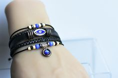 Items similar to Lucky Charm leather bracelet, 5 bracelets in one, Lucky bracelet with Cat's Eye Lucky Stone, Adjustable on Etsy Handmade Leather Jewelry, Leather Charm Bracelets, Lucky Stone, Lucky Charm, Leather Material, Soft Leather, My Etsy Shop, Charmed, Check