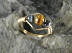 RING, WIRE WRAPPED, Size 9, 20 Gauge Yellow 14k Gold Filled Wire with a 6 mm Tiger's Eye in Center and 4 mm Black Fiber Optic Beads on sides by bopartpottery on Etsy