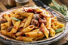 Zesty Penne, Sausage and Peppers: Penne pasta, Uncle Charley's Hot Italian Sausage, bell peppers & pasta sauce topped with parmesan cheese! #Dinner #Sausage #Recipe #Recipes #pasta