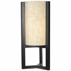 "Lantern-inspired table lamp with a wood frame and oatmeal-hued shade.     Product: Table lamp   Construction Material: Wood and fabric   Color: Madera bronze   Features: On/off line switch  Accommodates: (1) 100 Watt bulb - not included   Dimensions:  25"" H x 9"" Diameter"