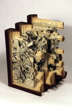 Cool book craft.  Need a book with interesting illustrations that layer