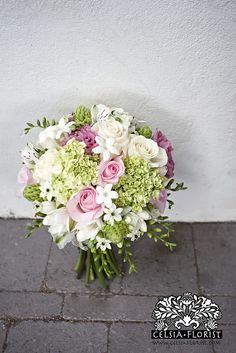 Celsia bridal bouquet of roses, stephanotis, mini green hydrangea, this shade of hydrangea for the soft green dress