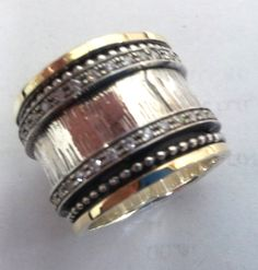 Hey, I found this really awesome Etsy listing at https://www.etsy.com/listing/237133719/spinner-ring-silver-band-gold-rings-for