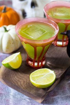 This Sour Frankenstein Cocktail is a fun party cocktail for Halloween. Don't let the green fool you: they're really just cucumber margaritas in disguise!