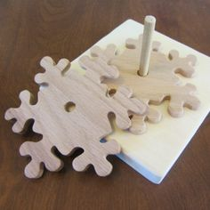 In this tutorial, you'll learn how to make festive snowflake coasters and a spindle holder using a scroll saw or bandsaw and a few other basic tools. This project would make a great hostess gift or add a touch of Scandinavian-style winter cheer to your decor. If you're new to woodworking, make sure you read our woodworking fundamentals tutorial. | Difficulty: Beginner; Length: Medium; Tags: Decorations, Woodwork, Homewares, Christmas