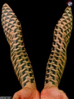 This guy's awesome full sleeve tattoo incorporates a crazy geometric pattern that makes both of his arms look like an optical allusion, a la the impossible staircase. The sleeve tattoo art is inked in black and white and features tons of symmetrical boxes piled on top of one another up ...