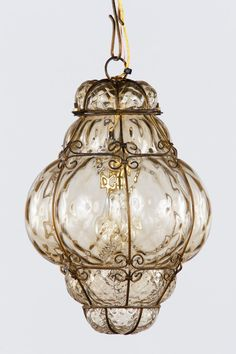 View this item and discover similar for sale at - A Murano wire cage lantern with handblown bubble glass in light amber tones. The fixture is housing a single medium socket light bulb. Antique Light Fixtures, Antique Lighting, Kitchen Lighting, Home Lighting, Lighting Ideas, Lighting Design, Chandelier Pendant Lights, Chandeliers, Modern Lanterns