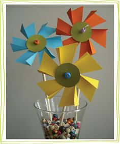 flower-pinwheels2.jpg  Tutorial for paper flower pinwheels.  Great DIY paper craft for kids.   Easter holiday decoration idea.