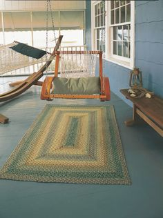 Braided rugs perfectly spruce up any front porch area
