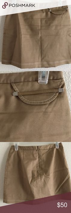 BCBG MaxAzria Tan Mini Skirt Size 0 BCBG MaxAzria Tan Mini Skirt Size 0. Pocket on the left side. Zips up in the back. Fabric: 64% Cotton 32% Polyester 4% Spandex Waist: 12.5 Length: almost 13.5 NO Snags, tears & Smoke free home. BCBGMaxAzria Skirts Mini