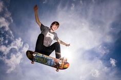 Skater pushes gravity to its limits while jumping in the air against spectacular sunny sky, partially blocking the sun creating an incredible sun flare. Sun Flare, Skate Park, World Best Photos, Photo Contest, Lifestyle Photography, The Incredibles, Community, Passion, Clouds