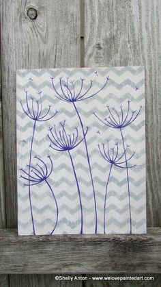 This rustic wood sign is hand painted in gray and white. It is hand painted with purple and black dandelions. by WeLovePaintedArt