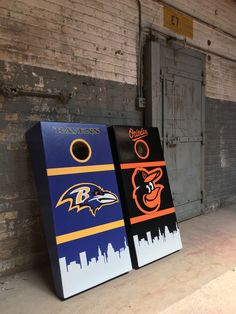 https://flic.kr/p/WsZvS8 | Custom Cornhole boards protected within 1940's style bomb shelter | Baltimore Ravens and Oriole custom cornhole game boards.