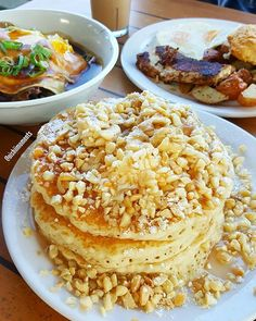 Whoa... This banana macadamia nut buttermilk pancake was delicious!  Especially topped with coconut syrup!!! That coconut and macadamia nut is sooo ... @JennEatsFood and I also enjoyed the kalua pork moco as well as their blackened fish & eggs breakfast special.