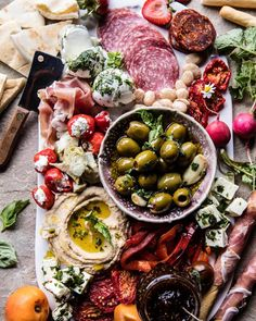 The weekend snacks are going to be on pointGiant appetizers platters with all the cheese, hummus, meats, olives, veggies, fruits, and bread. YUM
