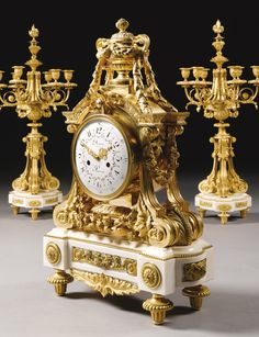 JEAN-FRANÇOIS AND GUILLAUME DENIÈRE FL. 1820-1901 A LOUIS XVI STYLE GILT BRONZE AND WHITE CARRARA MARBLE DOUBLE SIDED THREE PIECE CLOCK GARNITURE, PARIS, SECOND HALF 19TH CENTURY the black and white enamel dial with polychrome enamel garlands signed Denière / Ft de Bronzes / A Paris, the clock case surmounted by a classical vase, the candelabra with seven candle branches