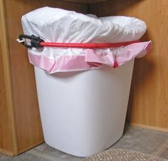 Keep garbage can from moving around in the camper, two eye hooks and a bungee cord