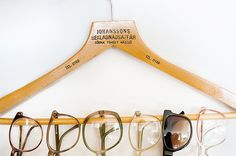 This would totally solve our merchandising problem for sunglasses (but a glittered hanger, of course). Eureka!