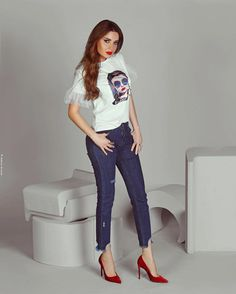 Cyrine Abdel nour in printed white t-shirt with ruffles .denim pants .red lipstick &shoes || 2020 trends