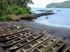 Dugout canoes are hauled out at Praia Sao João de Angolares on the southeast side of Sao Tome Island, São Tomé and Príncipe. The holes in the benches are for sails.