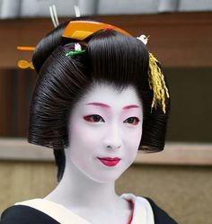 Geiko(Geisha)Kimika. After she finished her period of Maiko, she became a Geiko. (Maiko period is from 15 to 20 years old)