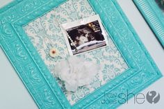put some beautiful fabric over a cork board or a magnetic board, then put it in a frame! :)
