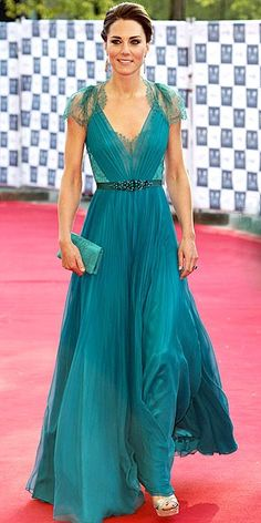 Probably one of the most stunning dress that we've seen Kate wearing, a gorgeous teal dress with lace back.