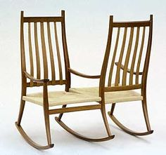 Reminds me of a victorian courting chair. I can't imagine where a rocker like this might fit into a home.